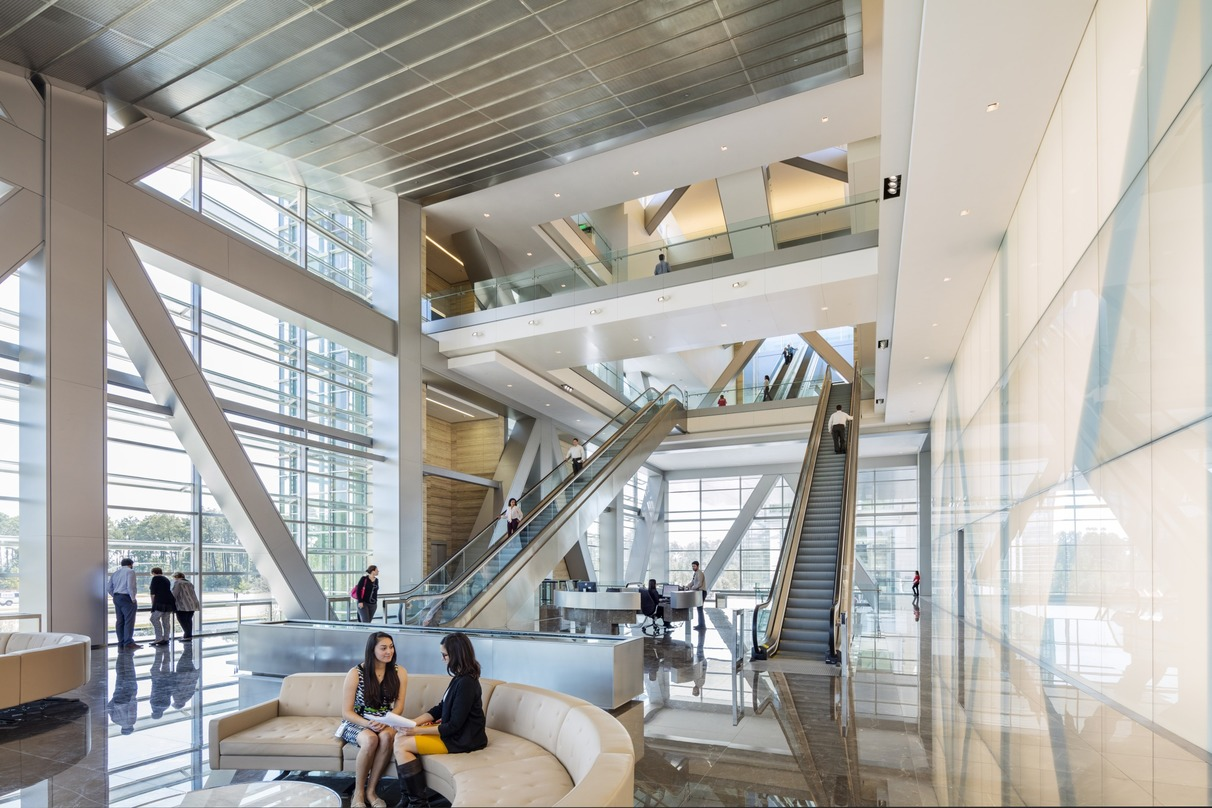 People interacting with each other inside the ExxonMobil Energy center, Houston, Texas.