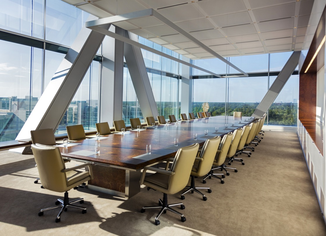 Conference room inside the ExxonMobil Energy Center with a picturesque view from the glass frame wall.