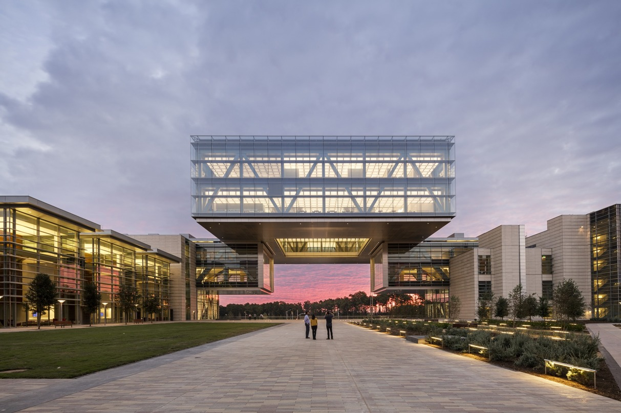 People gazing at the picturesque design of the ExxonMobil Energy Center located in Houston, Texas.
