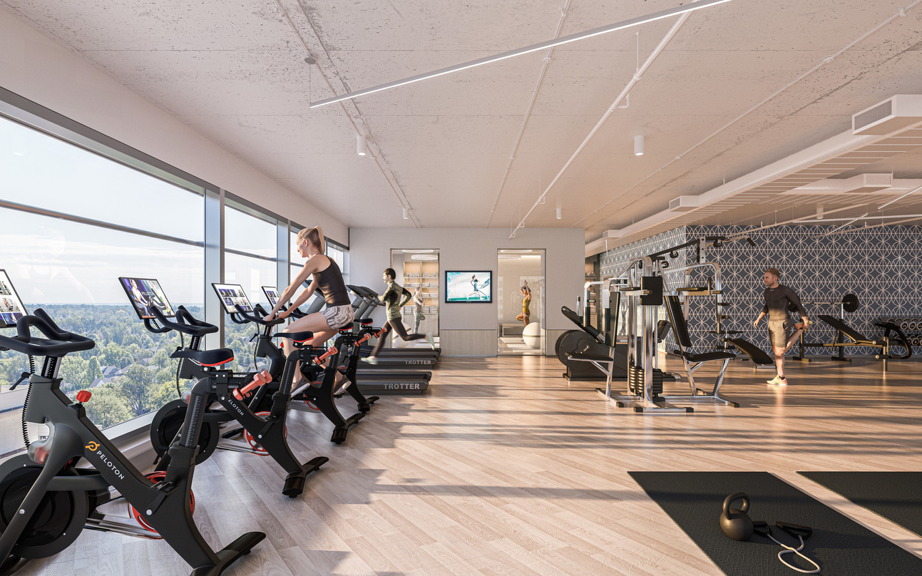 The workout room at Avocet Tower with glass frame walls.