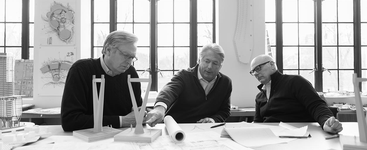 William D. Chilton discussing with his colleagues with miniature model designs for a project.