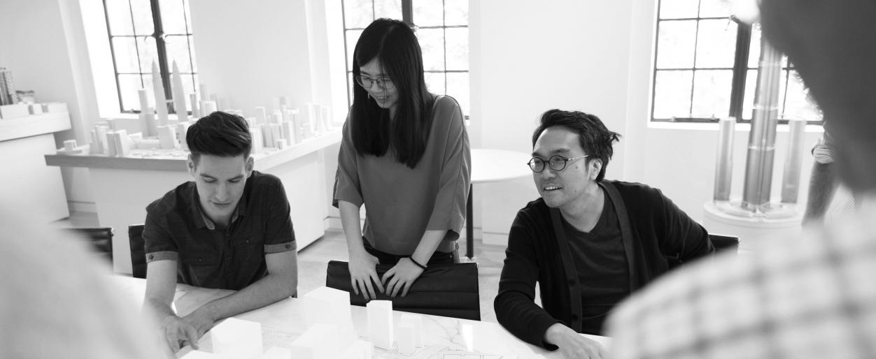 Ye-Ming Lee, Ashley Kim, and Jonathan Cook in a discussion at work.
