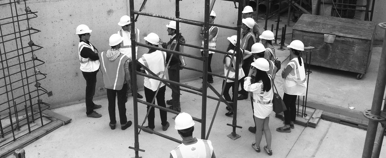 Architects in discussion at a construction site.