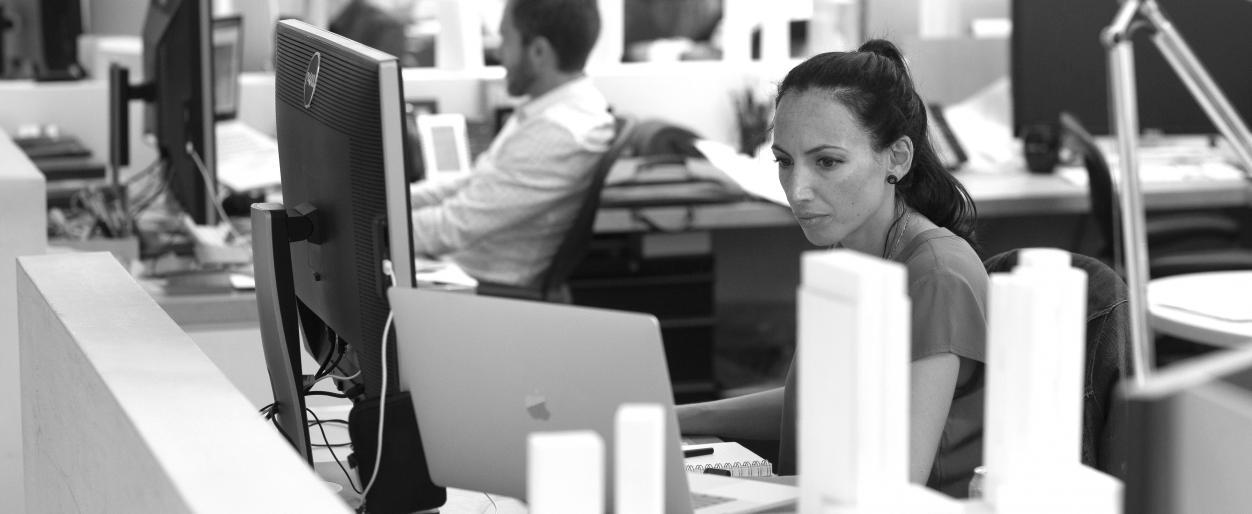 Javiera Palacio is working at her desk.