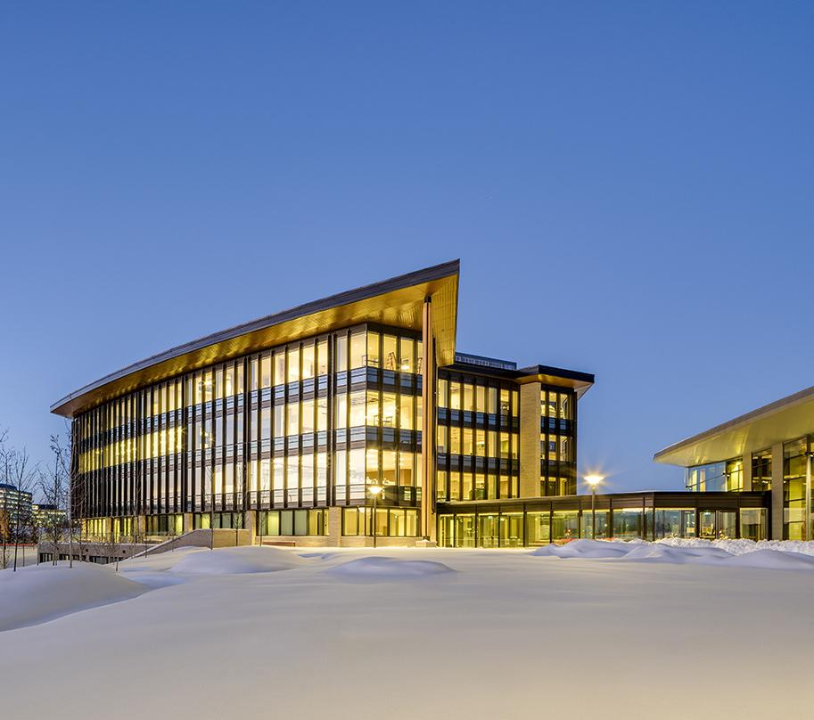 The LEED NC-Gold buildings are sited to provide panoramic views to the Rocky Mountains and the Calgary skyline and for an advantageous solar orientation. The first floor of the parkade creates a level plinth within the sloping landscape, upon which the buildings and central quad are sited.