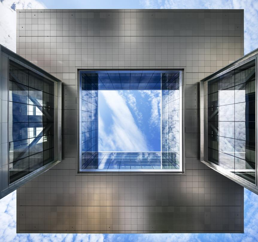 Cube shaped opening in the roof of ExxonMobil Energy Center, Houston, Texas for natural lighting.