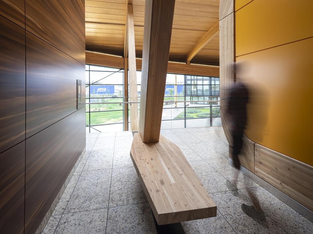 The warm wood structure signifies the heart of the campus and houses the Commons with an arched form that is derived from the hull of a wood strip canoe.