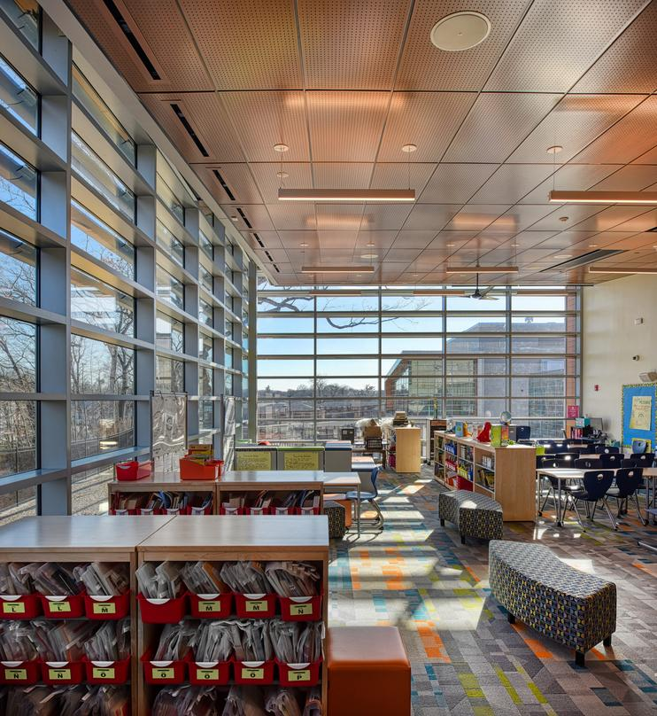 Interior designs of Barack H. Obama Magnet University school with glass frame walls in New Haven, Connecticut.