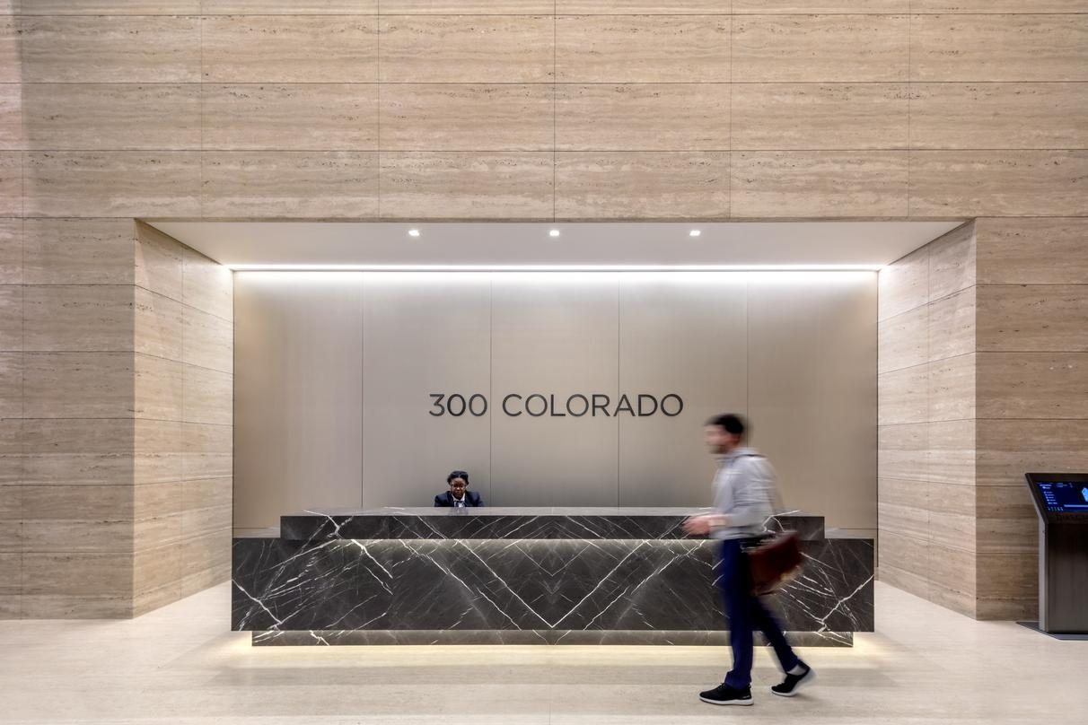 The minimalist design for welcome desk at 300 Colorado in downtown Austin.