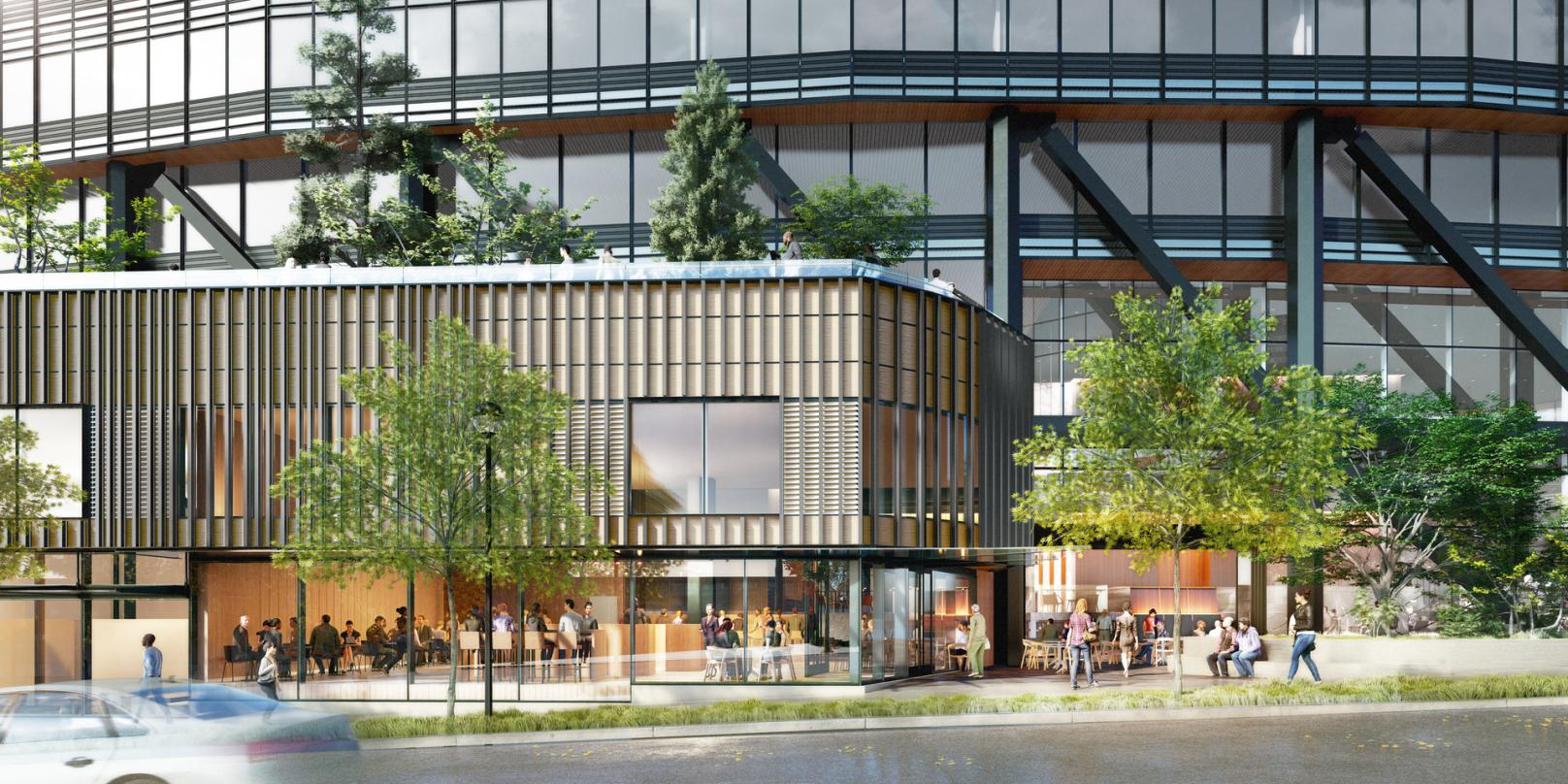 Pedestrian level view of dining area outside the next-generation Class A commercial office development design in Bellevue.