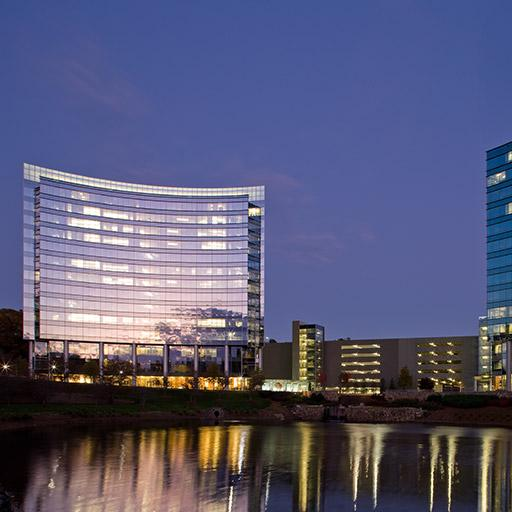 The curvilinear exterior of Newell Rubbermaid's headquarters reflecting in the two-acre pond at Atlanta, Georgia.