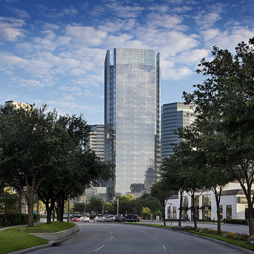 Exterior design of the office tower for BHP headquarters in Houston, Texas with adequate greenery on the road.