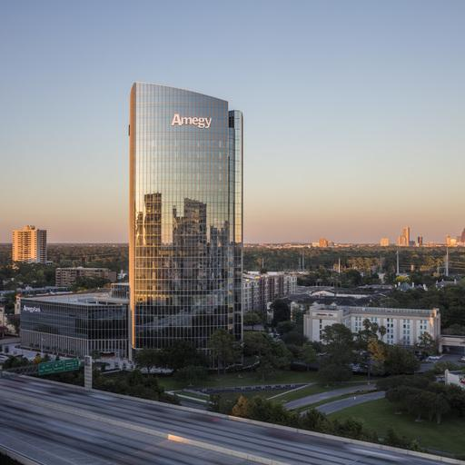 The exterior view of Amegy Bank's new headquarters built with curved glass facades, located in Houston, Texas.