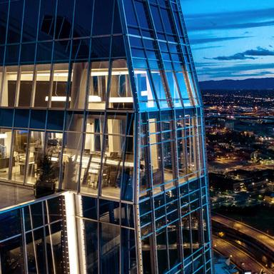 The lighted exterior view of a top storey in 1144 Fifteenth, a high performance office tower located in Denver, Colorado.
