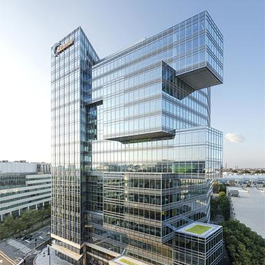 The exterior design of Akamai Headquarters located in Cambridge, Massachusetts with glass framed walls.