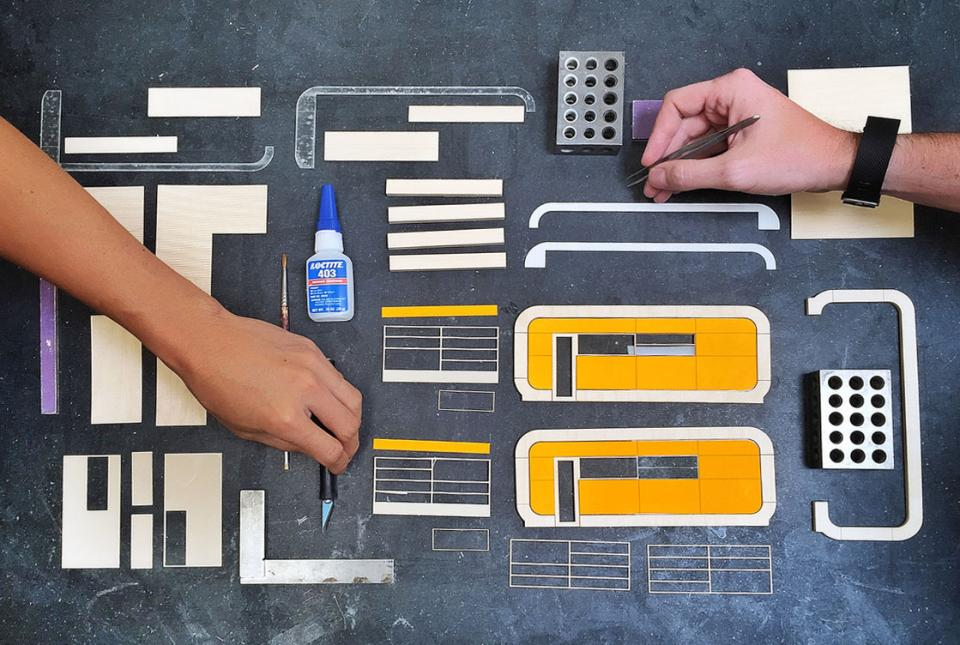 Things used by the Pickard Chilton team to create miniatures for a design proposal laid out on a table.