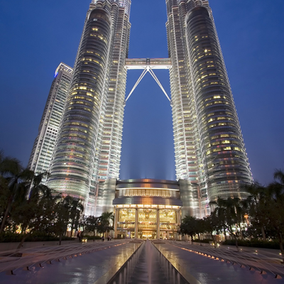 The exterior view of expansive glass curtain wall in Petronas Towers' concert hall, located Kuala Lumpur, Malaysia.