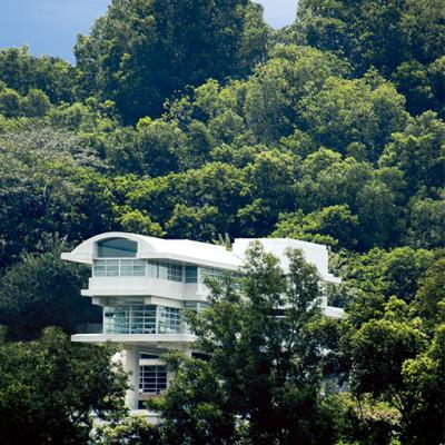 The exterior of a private residence in Kuala Lumpur, Malaysia with dramatic views set in a tropical region.