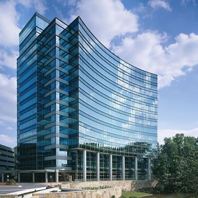 Glass framed walls of Oracle's headquarters at One Glenlake built with energy efficient materials to minimize the heat.